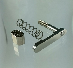 AR15 / AR10 Stainless Steel magazine release kit - includes magazine release, button and spring.